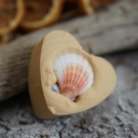 Orangen-Zimt-Herz mit Muschel